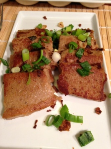 Turnip Cake with Daikon radish, tapioca flour base, fried onions, scalions, served with fig oyster dipping sauce