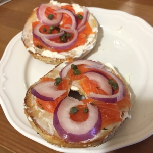 Cured Salmon, red onion, capers, cream cheese atop a toasted bagel.